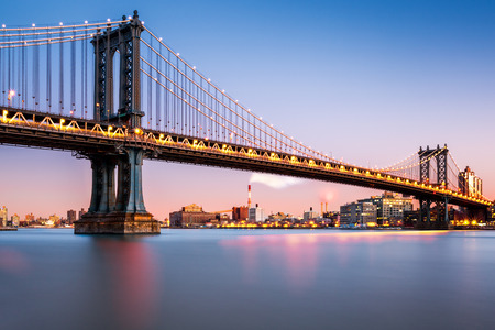 Manhattan Bridge illuminated at dusk (very long exposure for a perfectly smooth water)