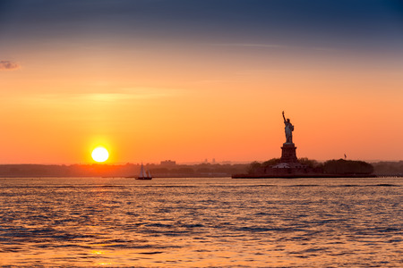 Statue of Liberty at sunset as viewed from Brooklyn New York