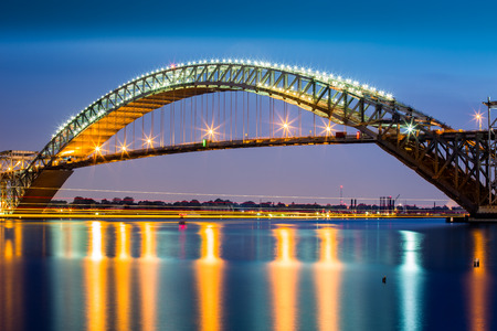 Bayonne Bridge at dusk. The Bayonne Bridge is the 5th longest steel arch bridge in the world spans the Kill Van Kull and connects Bayonne NJ with Staten Island NY