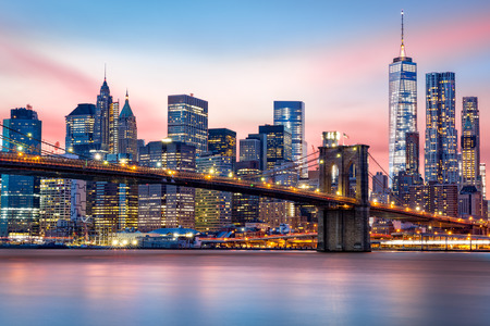 Photo for Brooklyn Bridge at and the Lower Manhattan skyline under a purple sunset - Royalty Free Image