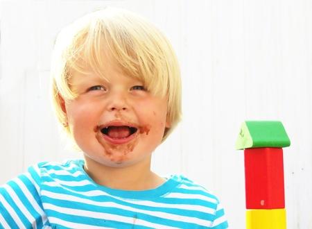 Young blonde boy after enjoying an ice cream in summer - kleiner blonder Junge nach dem Genuss von Schokoladen Eis im Sommer