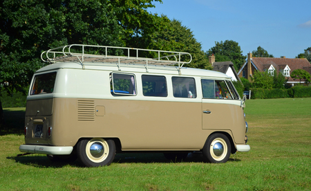 Photo for ICKWELL, BEDFORDSHIRE, ENGLAND -  JULY 02, 2017: Classic Volkswagen Camper Van parked on village green. - Royalty Free Image
