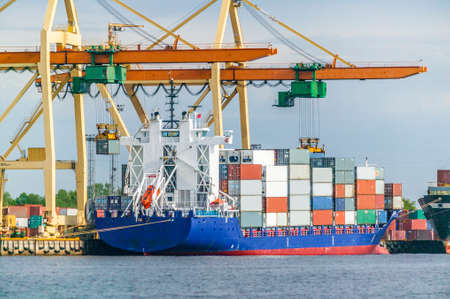 Photo for Cargo vessel are loaded in a container terminal - Royalty Free Image