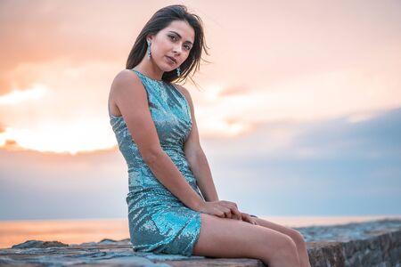 Photo pour Lifestyle, A caucasian brunette in a sunset sitting - image libre de droit