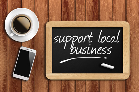 Photo pour coffee phone and chalkboard with make support local business words. - image libre de droit