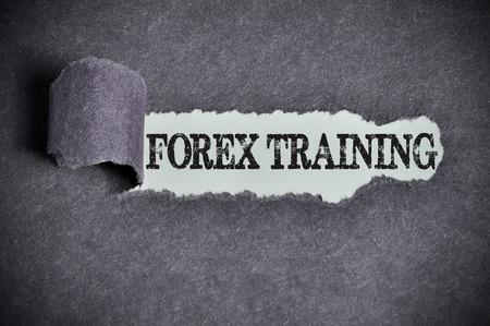 forex training word under torn black sugar paper.