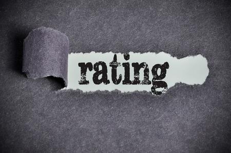 rating word under torn black sugar paper.