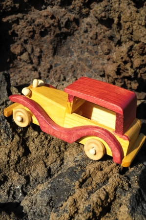 Transportation Concept Wooden Toy Car on the Rocks