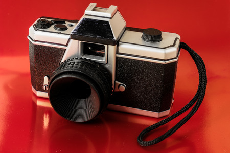Classic 35mm Plastic Toy Photo Camera on a Colored