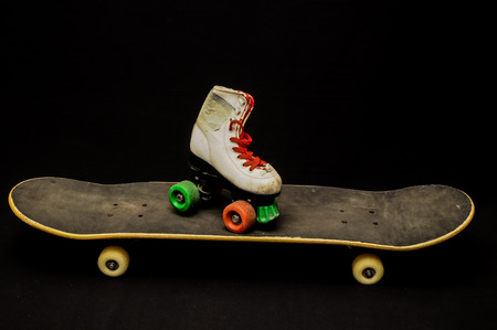 Vintage Style Black Skateboard and Skate Boot on a Dark Background