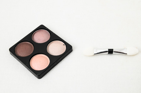 Make-up Palette Of Colorfully Eyeshadows Over White Background