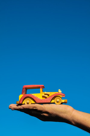 Transportation Concept Wooden Toy Car on the Hand