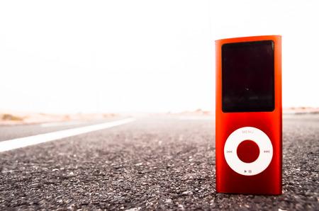 Vintage MP3 Music Player on an Asphalt Road