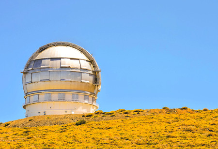 Photo Picture of a Modern Scientific Astronomical Observatory Telescope