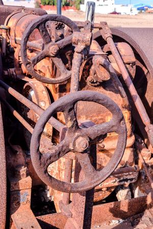 An old antique rusty grunge vintage steam roller part