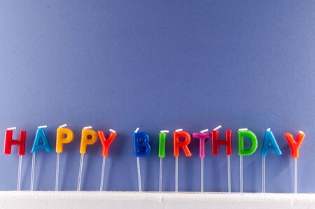 Photo pour Many Colored Candles with Text Happy Birthday - image libre de droit