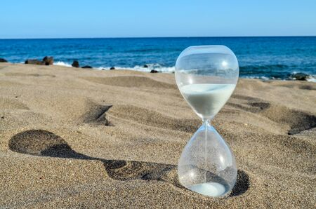 Photo pour Photo Picture of Hourglass Clock on the Sand Beach - image libre de droit