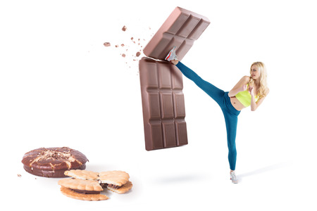 Beautiful blond girl resist temptation and fight back bad habbits, no to junk food