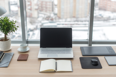 Photo for Office. Comfortable work table, workplace with notebook laptop - Royalty Free Image