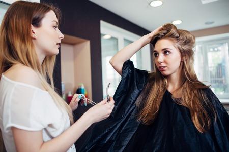 Foto für Hair stylist working on female customer s hairdo clipping strands with hair pins in hairdressing studio - Lizenzfreies Bild