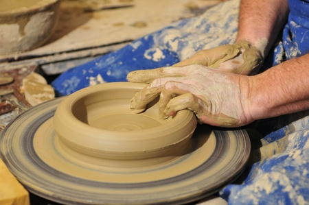 Potter's hands working on new pot.