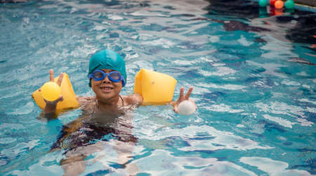 Photo for A boy swimming in the pool - Royalty Free Image