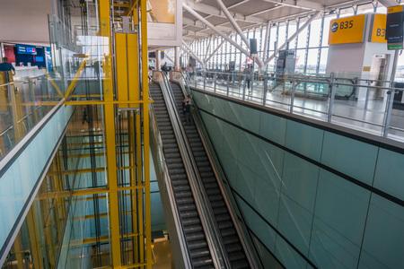 September 24, 2017 London/UK - People riding an escalator at Heathrow Airport