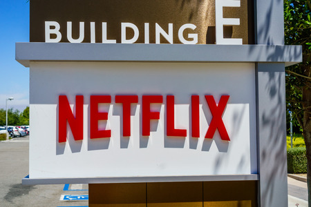 July 30, 2018 Los Gatos / CA / USA - Netflix logo in front of their headquarters situated in Silicon Valley; south San Francisco bay area