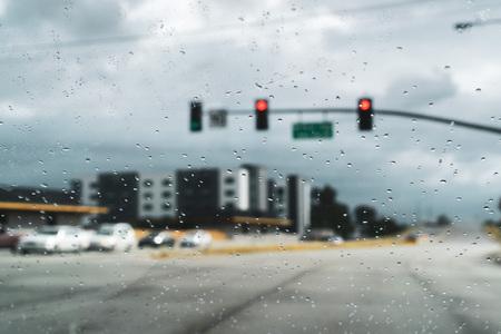 Driving on a rainy day; raindrops on the windshield; San Jose, California