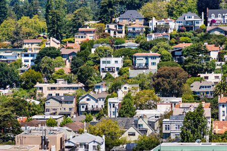 Aerial view of residential neighborhood built on a hill, Berkeley, San Francisco bay, California;