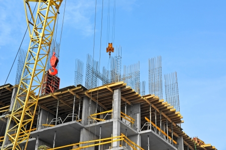 Photo for Crane and building construction site against blue sky - Royalty Free Image