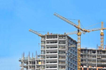 Foto für Crane and building construction site against blue sky - Lizenzfreies Bild