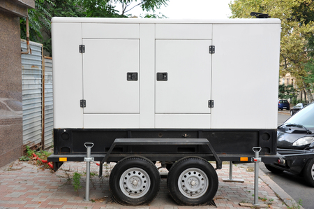 Mobil electric generator with power cable on street
