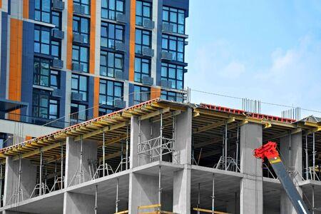 Photo pour Building construction site work against blue sky - image libre de droit