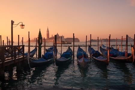 Gondolas in venice at sunset - San Giorgio maggiore on background