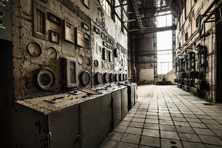 Photo pour rusty control unit in an old abandoned factory building - image libre de droit