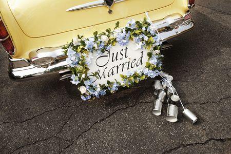 Just married sign on bumper of vintage car