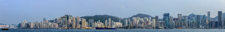 Photo for Huge Cityscape Panorama with Victoria Bay, Port, Transportation Ships and Hongkong Island in the background. Hong Kong, China, Asia - Royalty Free Image
