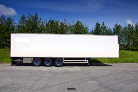 Foto de white air conditioned truck trailer for haulage transporting - Imagen libre de derechos