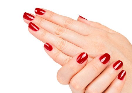 Close up of Female hands with red manicure