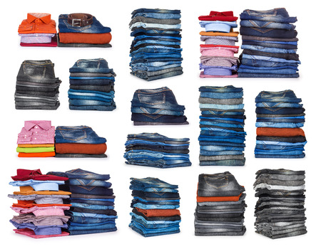 Foto de collection stacks of jeans on a white background - Imagen libre de derechos