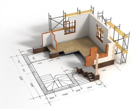 House with open interior on top of blueprints