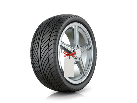 Automotive wheel with a tag on a white background.