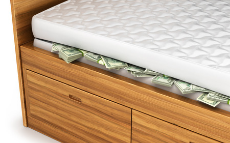 Money, dollars hidden under a white mattress.