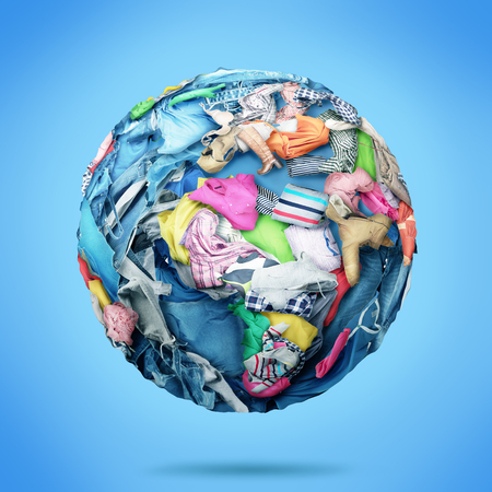 Photo for Planet made of clothes on a blue background. Donation. - Royalty Free Image