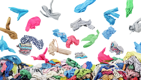 Photo for Separate clothing falling at the big pile of clothes on a white background - Royalty Free Image