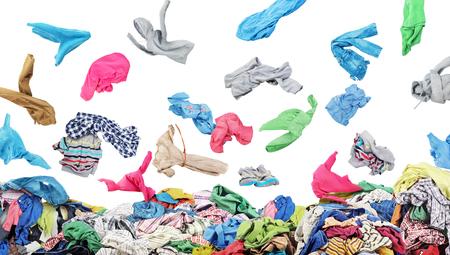Foto de Separate clothing falling at the big pile of clothes on a white background - Imagen libre de derechos