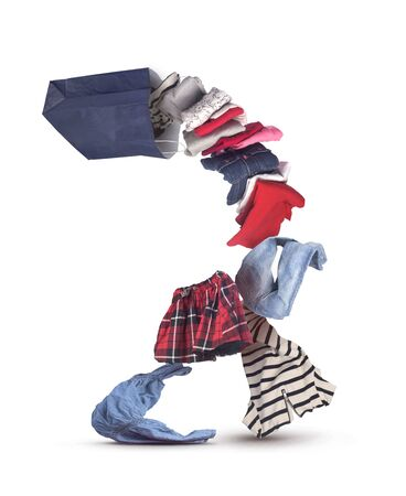 Photo pour stack of falling clothing out off shopping bag isolated on white - image libre de droit