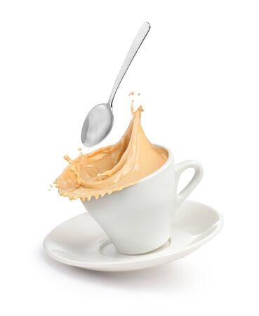 Photo pour A splash of coffee with milk in a cup. - image libre de droit