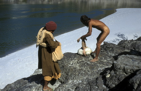 two men on the Ganges River in the town of Rishikesh in the Province Uttar Pradesh in India.